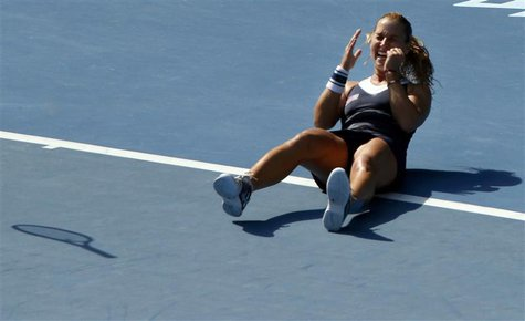 Dominika Cibulkova of Slovakia celebrates defeating Agnieszka Radwanska of Poland in their women's singles semi-final match at the Australia