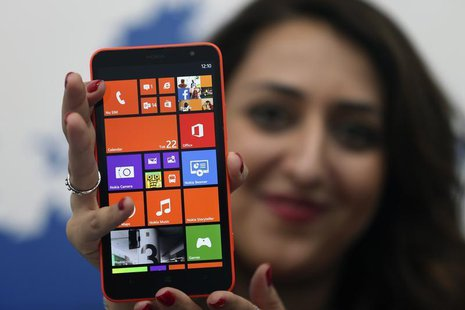 A model displays the Lumia 1320 smartphone during its launch in Abu Dhabi October 22, 2013. REUTERS/Ben Job