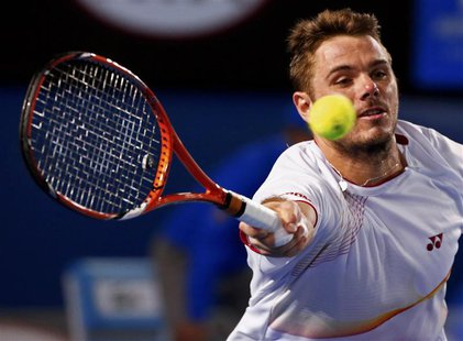 Stanislas Wawrinka of Switzerland hits a return to Tomas Berdych of the Czech Republic during their men's singles semi-final match at the Au