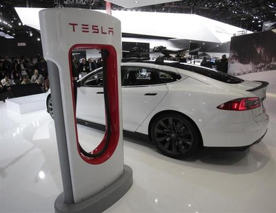A Tesla S electric car and a charging station are displayed during the press preview day of the North American International Auto Show in De