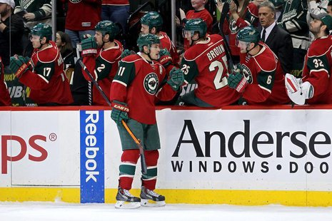 Dec 17, 2013; Saint Paul, MN, USA; Minnesota Wild forward Zach Parise (11) celebrates his goal with teammates during the first period agains
