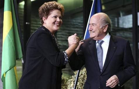 Brazil's President Dilma Rousseff (L) greets FIFA President Sepp Blatter during a visit at the FIFA headquarters in Zurich January 23, 2014.