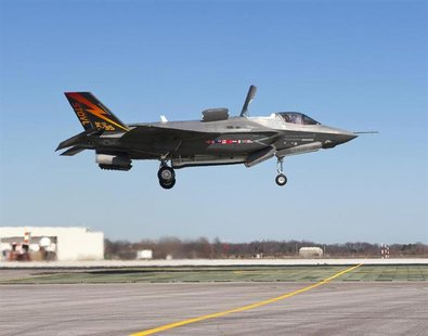 The supersonic Lockheed Martin F-35B Lightning II stealth fighter, piloted by Graham Tomlinson, lands vertically for the first time at Naval