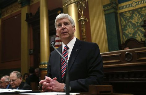 Michigan's Governor Rick Snyder gives his annual State of the State address to the Assembly at the State Capitol in Lansing, Michigan Januar