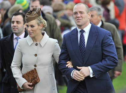 Britain's Zara Phillips (L) and her husband Mike Tindall walk to St. Mary's church to attend the annual Christmas service on the Royal Estat