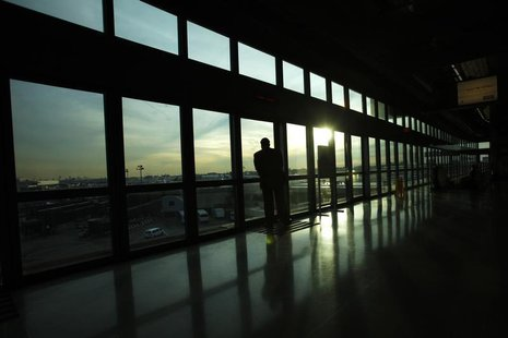 A passenger watches the Newark Liberty International Airport from the airtrain station in Newark, New Jersey November 15, 2012. REUTERS/Edua