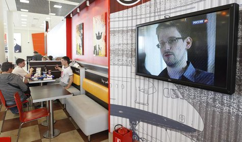 A television screen shows former U.S. spy agency contractor Edward Snowden during a news bulletin at a cafe at Moscow's Sheremetyevo airport