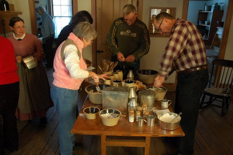 Participants in a past Hearthside Dinner work on preparing the food.
