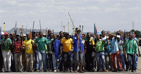 Mine workers protest outside the Lonmin mine in Rustenburg, northwest of Johannesburg January 23, 2014. REUTERS/Siphiwe Sibeko