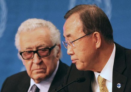 U.N. special envoy for Syria Lakhdar Brahimi speaks to U.N. Secretary-General Ban Ki-moon (R) during a news conference after the Geneva-2 pe