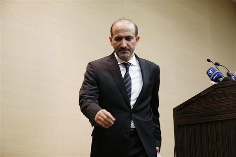 Syrian opposition leader Ahmed Jarba leaves a news conference in Geneva January 23, 2014. REUTERS/Jamal Saidi