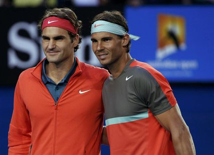 Roger Federer (L) of Switzerland poses for a photo with Rafael Nadal of Spain before their men's singles semi-final match at the Australian