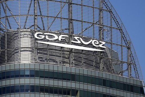 The logo of French group GDF Suez is seen on a building in the financial district of La Defense, near Paris August 1, 2013. REUTERS/Benoit T
