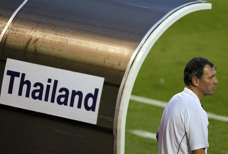 Bryan Robson, head coach Thailand's national team, watches their friendly match against Leicester City in Bangkok October 9, 2010. REUTERS/D