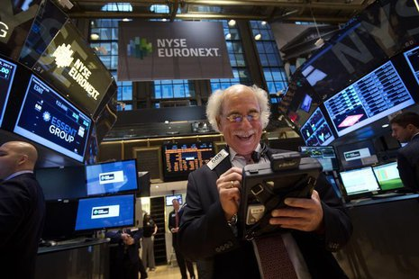 Trader Peter Tuchman smiles as he works on the floor of the New York Stock Exchange after the market opening in New York, December 23, 2013.