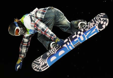 Gold medalist Shaun White of the United States competes during his second run in the men's snowboarding halfpipe on Cypress Mountain at the