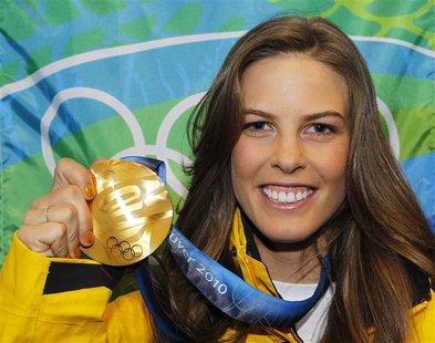 Gold medallist Torah Bright of Australia, poses with her medal during the medal ceremony for the women's halfpipe at the Vancouver 2010 Wint