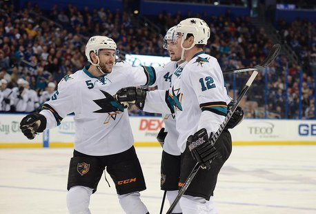 Jan 18, 2014; Tampa, FL, USA; San Jose Sharks defenseman Jason Demers (5), center Patrick Marleau (12) and defenseman Marc-Edouard Vlasic (4