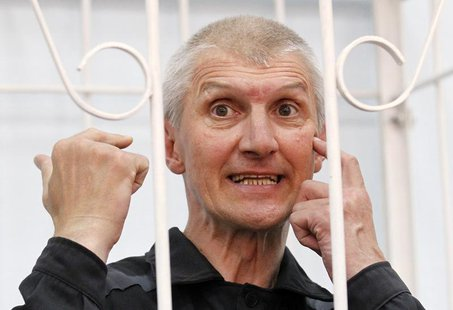 Platon Lebedev, jailed business partner of Russian ex-tycoon Mikhail Khodorkovsky, gestures after hearing the verdict inside the defendants'
