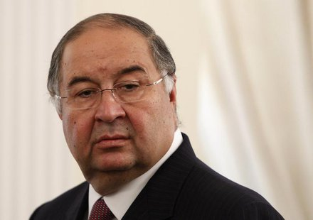 Uzbek-born Russian businessman Alisher Usmanov attends a meeting between Russian President Vladimir Putin and Crown Prince of Abu Dhabi Shei