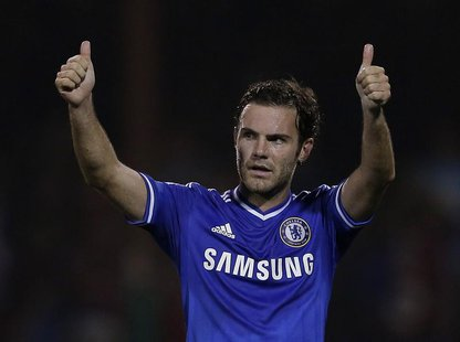 Chelsea's Juan Mata acknowledges the fans after winning their game against Swindon Town in their English League Cup soccer match at the Coun
