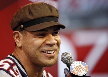 New England Patriots' Junior Seau answers questions during media day for the National Football League's (NFL) Super Bowl XLII in Glendale, A