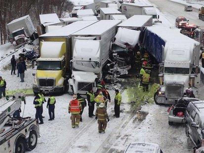 Trucks and passenger vehicles block eastbound Interstate 94 following a massive crash that killed three people and injured about 20 near Mic