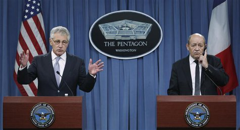 U.S. Secretary of Defense Chuck Hagel (L) and French Minister of Defense Jean-Yves Le Drian conduct a joint news conference after their meet