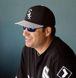 Chicago White Sox manager Robin Ventura looks on from the dugout during their MLB Cactus League spring training baseball game against the Mi