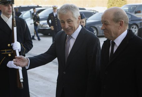U.S. Secretary of Defense Chuck Hagel (L) welcomes French Minister of Defense Jean-Yves Le Drian before their meeting at the Pentagon in Was