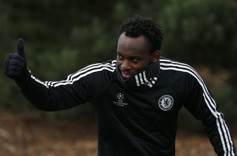 Michael Essien of Chelsea gives a thumbs up as he arrives for a team training session at their training facility in Stoke D'Abernon, south o