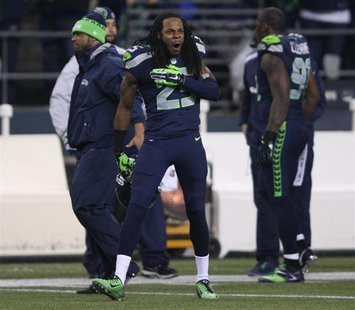 Seattle Seahawks cornerback Richard Sherman taunts San Francisco 49ers players during the fourth quarter in the NFL's NFC Championship footb