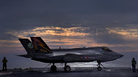 The F-35B Lighting II variant of the Joint Strike Fighter sits on the deck of the amphibious assault ship USS Wasp while being tested by Mar