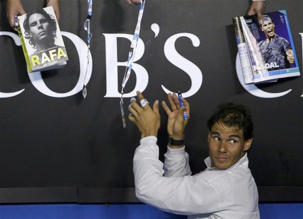 Rafael Nadal of Spain signs autographs after defeating Roger Federer of Switzerland in their men's singles semi-final match at the Australia