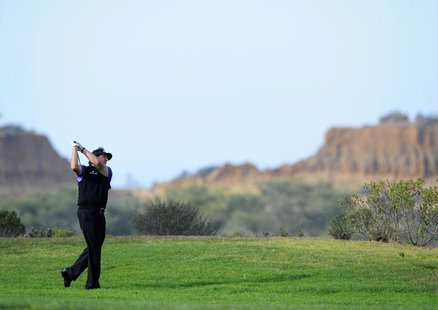 Jan 23, 2014; La Jolla, CA, USA; Phil Mickelson watches his second shot on the eighth hole during the first round of the Farmers Insurance O