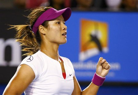 Li Na of China reacts during her women's singles final match against Dominika Cibulkova of Slovakia at the Australian Open 2014 tennis tourn