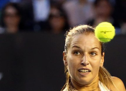 Dominika Cibulkova of Slovakia watches the ball as she hits a return to Li Na of China during their women's singles final match at the Austr