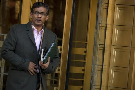 Conservative commentator and best-selling author, Dinesh D'Souza exits the Manhattan Federal Courthouse in New York, January 24, 2014. Credit: Reuters/Brendan McDermid