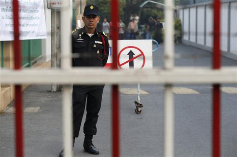 A Bangkok district officer stands inside the compound of a polling station in central Bangkok January 26, 2014. Thai authorities told anti-g