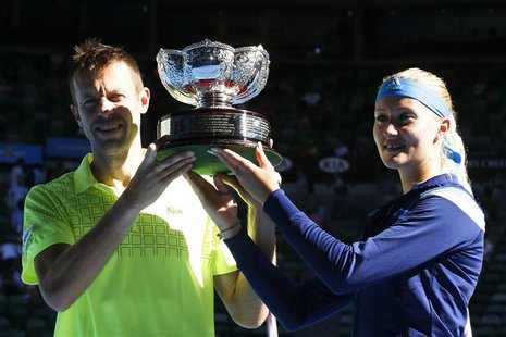Kristina Mladenovic of France and Daniel Nestor of Canada pose with the trophy after defeating Horia Tecau of Romania and Sania Mirza of Ind