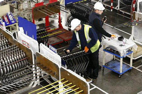Workers inspect components on the fuel inlet production facility at Futaba Industrial in Foston, central England in this January 21, 2014 fi