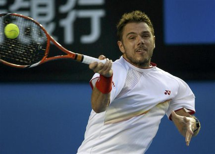 Stanislas Wawrinka of Switzerland hits a return to Rafael Nadal of Spain during their men's singles final match at the Australian Open 2014