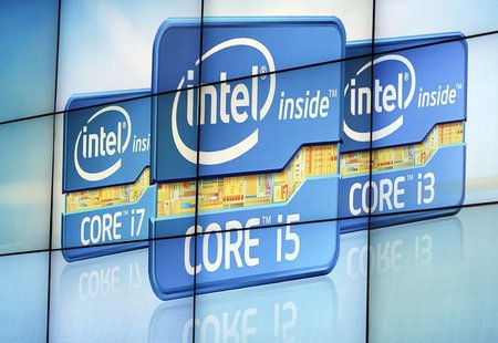 A video wall displays Intel's logos at the unveiling of its second generation Intel Core processor family during a news conference at the Co