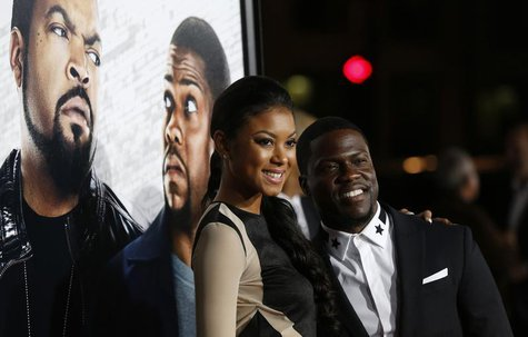 "Cast member Kevin Hart and Eniko Parrish pose at the premiere of ""Ride Along"" at the TCL Chinese theatre in Hollywood, California January 13"