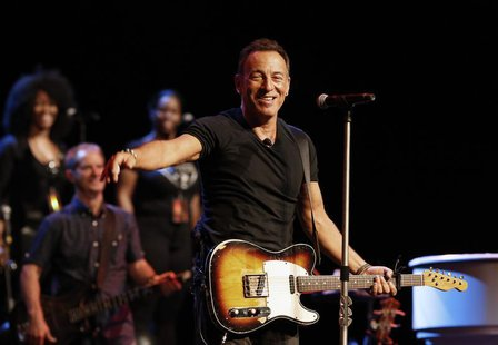 Singer Bruce Springsteen greets journalists during a sound check session ahead of his concert in Cape Town, January 26, 2014. REUTERS/Mike H