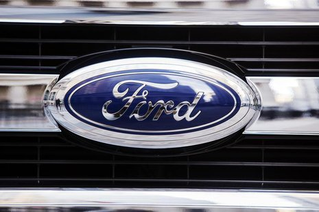 A Ford logo is seen on the grill of a 2015 F-150 truck outside the New York Stock Exchange in the Manhattan borough of New York, January 13,
