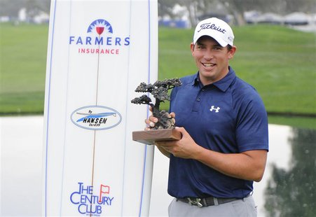 Jan 26, 2014; La Jolla, CA, USA; Scott Stallings poses with the Farmers Insurance Open championship trophy after the third round of the Farm