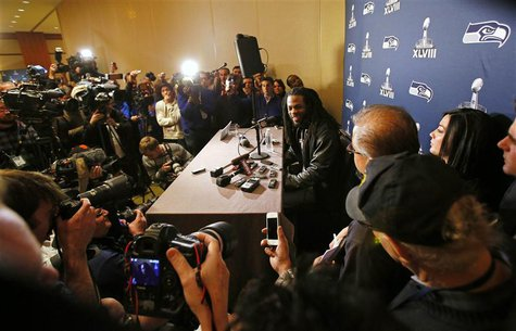 Seattle Seahawks cornerback Richard Sherman speaks during a news conference after the team's arrival for Super Bowl XLVIII against the Denve