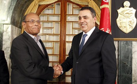 Tunisian President Moncef Marzouki (L) shakes hands with Tunisia's Prime Minister-designate Mehdi Jomaa after Jomaa spoke during a news conf