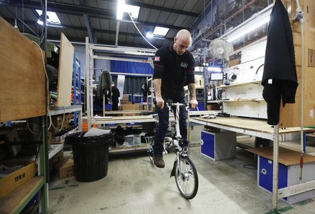 Dino Martins give a bike its final inspection at the Brompton Bicycle factory in west London January 10, 2014. REUTERS/Luke MacGregor